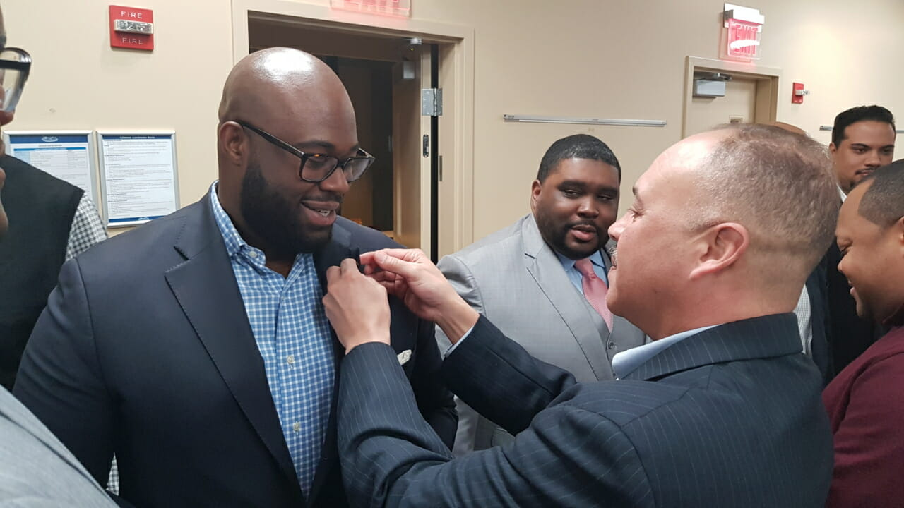 President Mark Elzy pinning a new inductee.